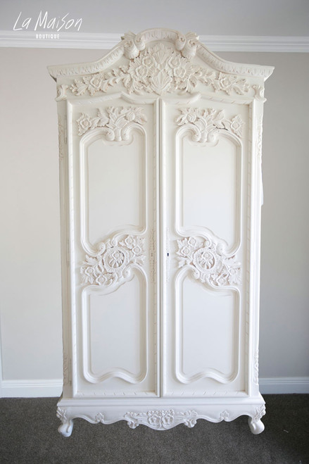 ORNATE CARVED ARMOIRE