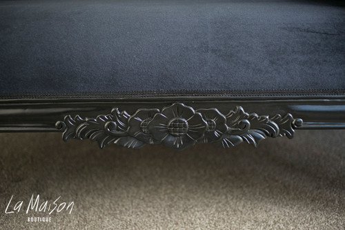 Hand carved detail on the chaise longue