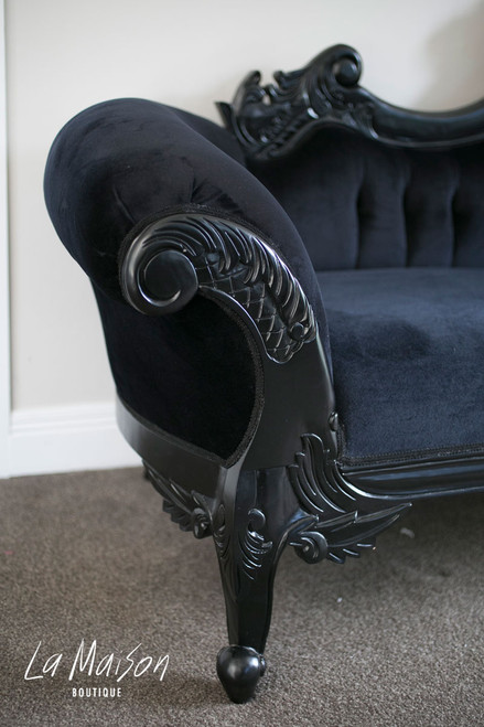 Hand carved detail on the chaise lounge