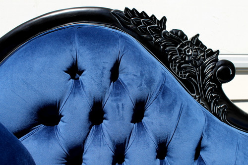 Detail of the hand carving on the chaise