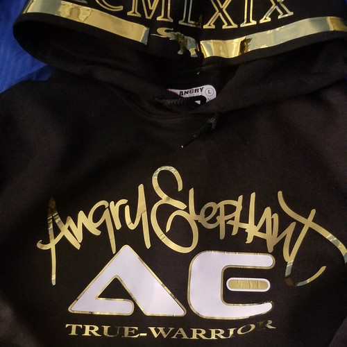Gold-Metallic. Black/w Gold outline and Script.