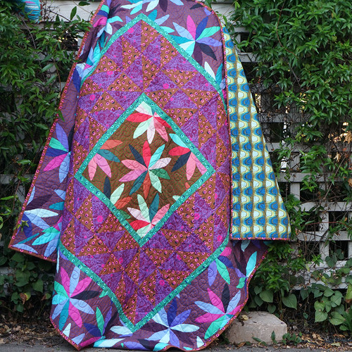 """Flips Quilt featuring Passionflower"" Free Medallion Quilt Pattern designed by Brittney Anderson from Free Spirit Fabrics"