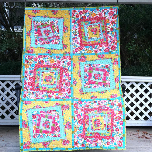 """Crazy Flowers"" Free Baby Quilt Pattern designed by Odile Bailloeul from Free Spirit Fabrics"