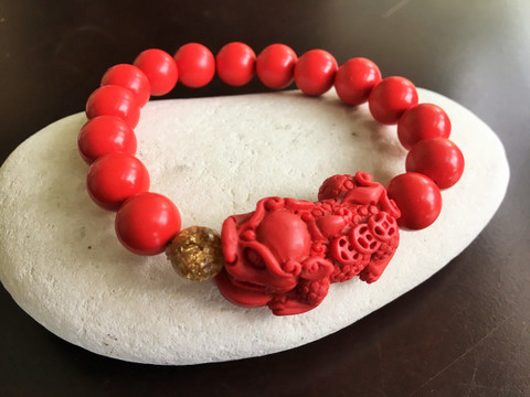Red Pi Yao Bracelet, Wealth amulet