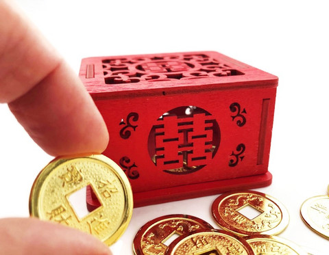 Coins under bed to promote a positive shift in your Finances