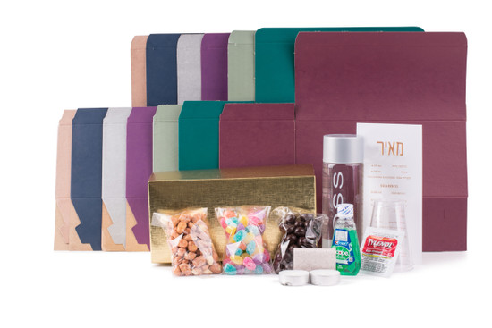 A complete welcome package for your guest. Available  in an array of colors. Includes,  Voss water, chocolates, nuts and candy, along with mouthwash, tylenol,  tealites & matches. Customizable.