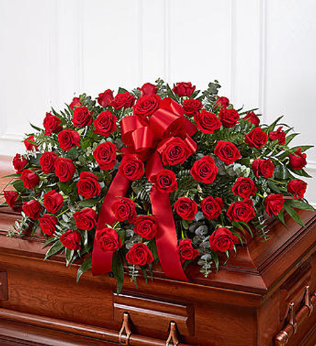 Red Rose Half Casket Cover When someone near and dear to us passes, it's natural to want to express all the love and admiration we have in our hearts. Nothing conveys this better than a  classic display of red roses. Our half casket cover, crafted with care and artistry by our expert florists with over 50 premium  red roses, fresh greenery, and accented with a red satin ribbon, is an unforgettable way to commemorate a lifetime of esteem and adoration.
