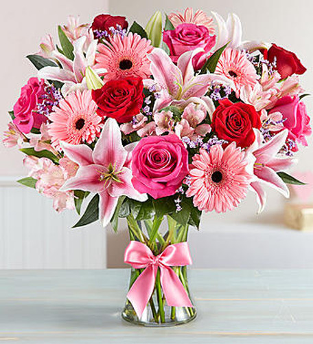 Fields of Europe Romance Inspired by the rich beauty of the European countryside, our romantic bouquet reveals all the feelings you have in your heart. Fresh-picked pink & red blooms are on display inside a glass vase finished with ribbon, creating a timeless gift for someone you love.