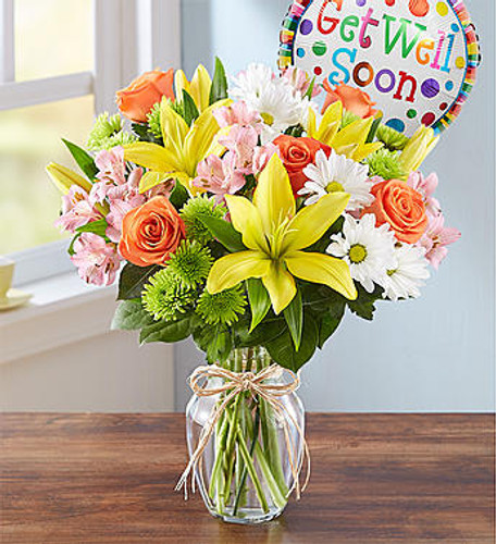 Fields of Europe Get Well Lift someone's spirits with a cheerful bouquet inspired by the gardens of Europe. Artistically gathered inside a glass v ase accented with raffia, and paired with a colorful Get Well balloon, it's the perfect prescription for a happy heart and a speedy recovery.