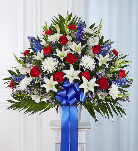 The love they showed for their country is as deep as the love felt by those mourning their loss. Meticulously crafted by our expert florists to honor a proud veteran who has passed away, our majestic standing basket arrangement is filled with lush blooms in patriotic red, white and blue, creating a fitting final tribute for the funeral services.