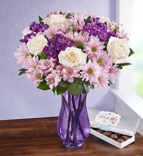 A gathering of fresh-from-the-garden blooms in soothing shades of lavender and white, our lovely bouquet will put a smile on the face of someone very special.