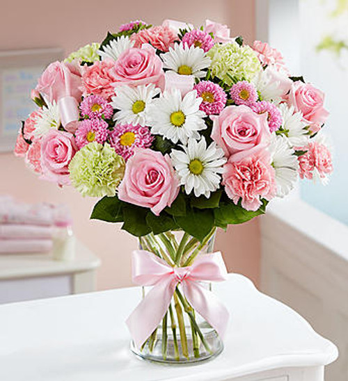 Sweet Baby Girl Arrangement A precious baby girl has arrived and you couldn't be happier! Surprise the proud new parents with our perfectly-girly pink bouquet. Designed inside a glass vase finished with pink ribbon  accents, it's a sweet way to welcome their little bundle of joy into the world.