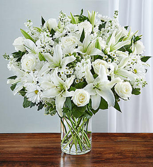 Sincerest Sorrow All White Express your sincere condolences with our elegant all-white arrangement of roses, lilies, stock, daisy poms and monte casino. A peaceful tribute that offers treasured memories of loved ones.