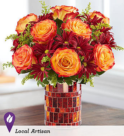 Amber Waves DESIGN COUNCIL EXCLUSIVE  A shimmering mosaic vase sets our unique autumn arrangement apart from the rest. Floral designer Anthony Swick of Tampa gathered warm red & orange blooms, creating the perfect complement of color for the keepsake, amber glass mosaic container. Beautifully catching the light, this antiqued piece can later be repurposed as a candleholder (there's a tea light included) or as a sparkling seasonal accent.