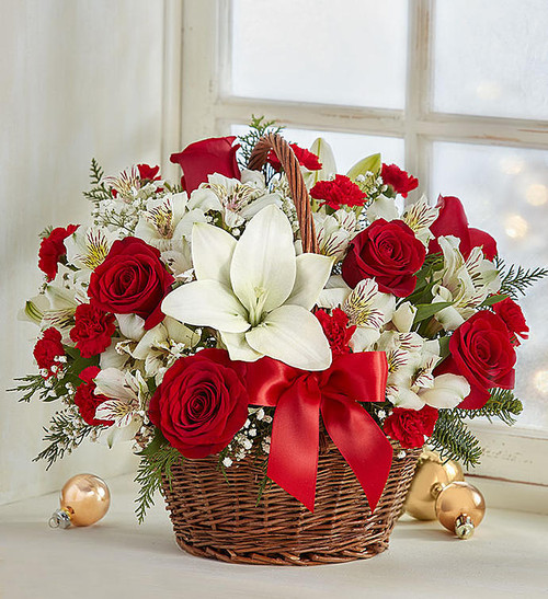 Spread holiday cheer with our basket of blooms. Capturing the natural beauty of flowers picked fresh from the European countryside, this hand-gathered arrangement is designed in Christmas colors, creating a joyful surprise for family & friends. Makes a charming centerpiece for all the celebrations of the season!