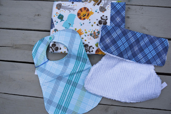 Shown with Zoo animal print blanket and light blue plaid bib, sold separately!