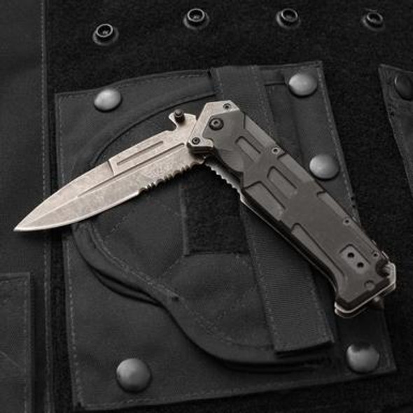 This UZI Stone Wash V Folding Knife is perfect for all your outdoor needs! UZI combines advanced technical concepts with innovative designs to produce products used and trusted by the Army, Secret Service and Special Forces. With it's serrated edge, stainless steel blade, G10 handle and metal pocket clip. The blade is stone washed and the black G10 handle offers added comfort and grip and a modern design. Spring Assist makes this knife easy to open.