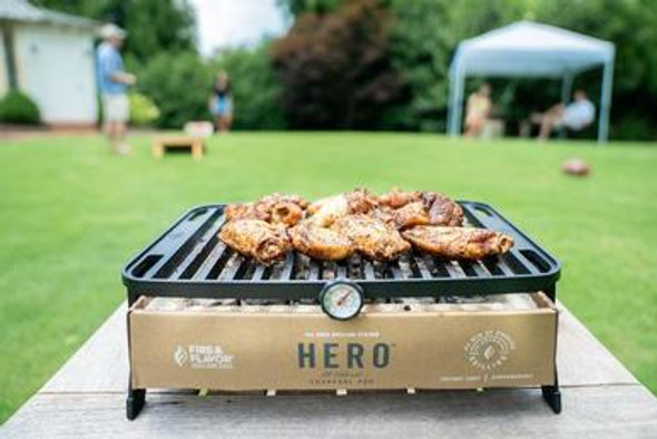 The Fire & Flavor HERO Grill is the world's first environmentally friendly and premium portable grill that uses a biodegradable charcoal pod to make grilling clean, simple and highly portable. he grill is lightweight, foldable to the size of standard laptop and, better yet, is dishwasher friendly. HERO single-use charcoal pods are vacuum sealed and simple to dispose of or compost after each use. The charcoal pod is earth friendly in that it is comprised of cardboard, lava stones and all-natural, instant-light charcoal briquettes.