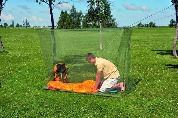 Coghlan's Mosquito Net fits over two cots or bags, suspends with poles or ropes (not included) Made from an ultra-fine 240 polyester mesh. Rectangular shape with six reinforced tie tabs.