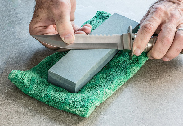 Our sharpening stone is double sided and features two grits; 120 and 240. 120 more coarse and is great for repairing damage on a blade or edge of a tool. 240 is less coarse and is great for providing a more finished edge.