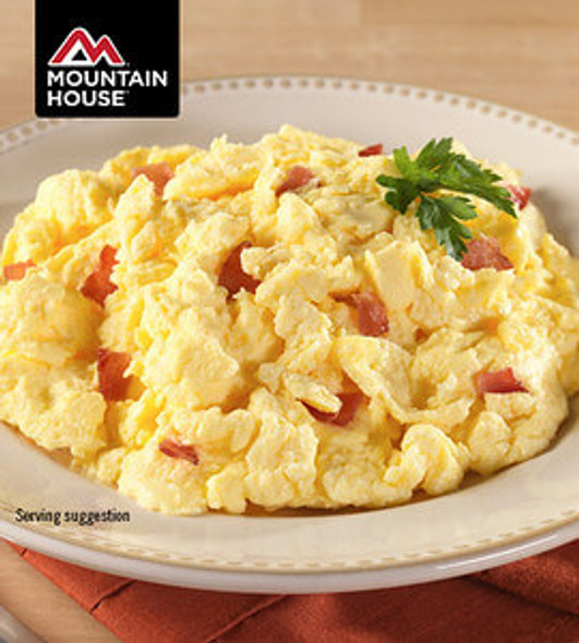 Mountain House Scrambled Eggs with Bacon Pouch. Who knew bacon and eggs could be so portable? These pre-cooked scrambled eggs include bacon pieces that are sure to meet the demand of any adventure.