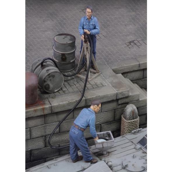 Men refuelling