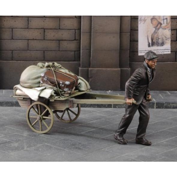 Evacuee pulling cart