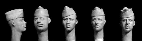 5 heads, wearing US Overseas caps