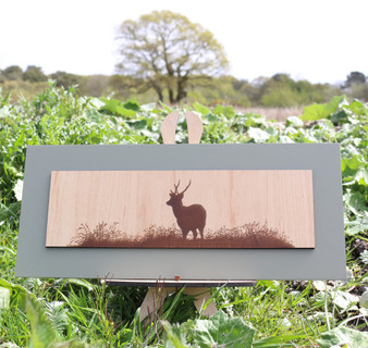 Wood engraving on Maple, Stag gazing across the field