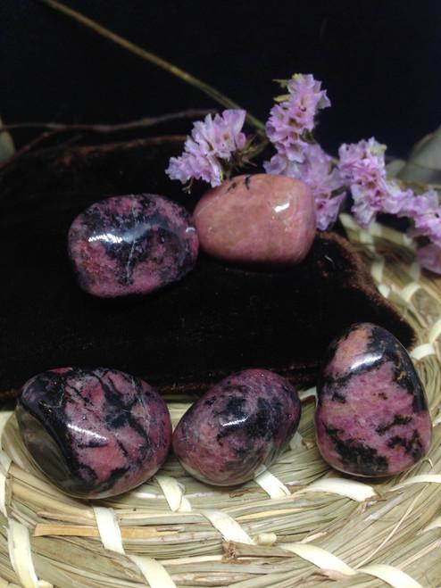 A grade Rhodonite tumbles