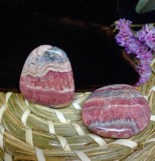 Rhodochrosite palm stone