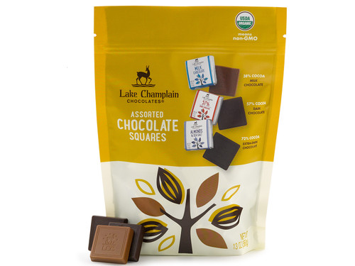 Assorted milk and dark chocolate squares sitting against an Assorted chocolate squares resealable bag View Product Image