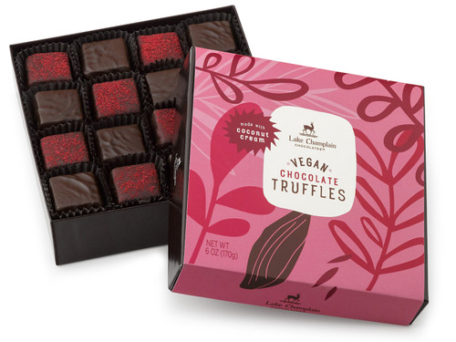 Assorted dark chocolate and dark chocolate raspberry vegan truffles made with coconut cream in a pink and brown gift box View Product Image