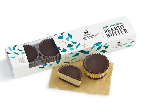 New dark peanut butter chocolates in a gift box with a clear section on the top peaking into package and 1.5 peanut butter chocolates outside the package View Product Image