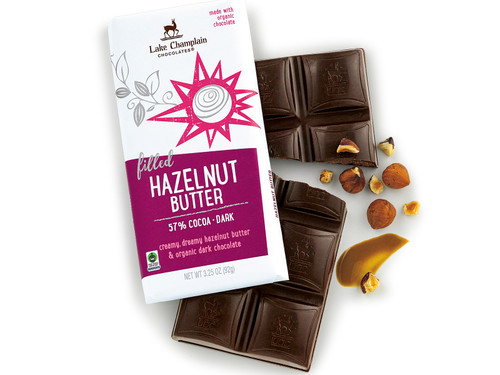 Hazelnut butter dark chocolate bar one in the package and one out of the package with pieces of hazelnuts and a smudge of hazelnut butter View Product Image