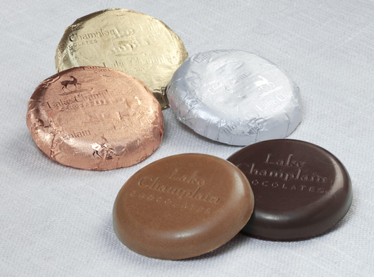 assorted milk and dark chocolate coins wrapped in foil and unwrapped