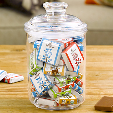 Assorted chocolate squares in an acrylic candy jar with LCC logo