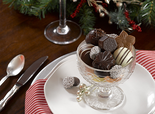 assorted chocolates in a holiday tablesetting