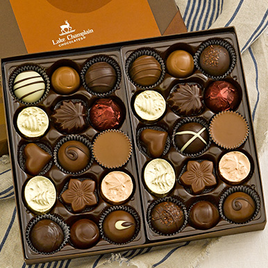 Assorted gourmet chocolates in a brown gift box