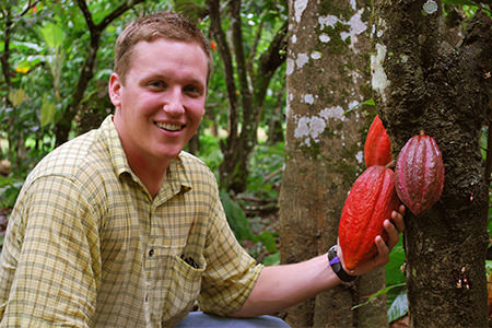 Eric Lampman holding a cacao pod