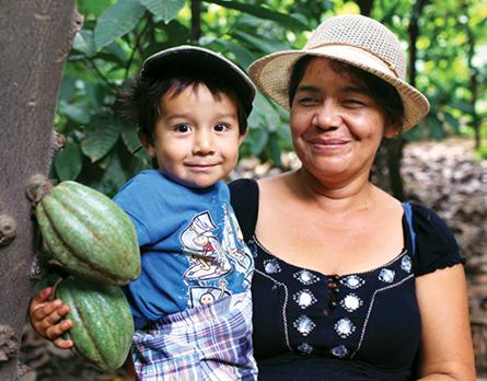 fair trade cocoa farmer and child