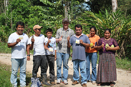 a group of Guatemalan cacao farmers with chocolate made from their beans