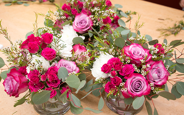 a collection of pink flower arrangements