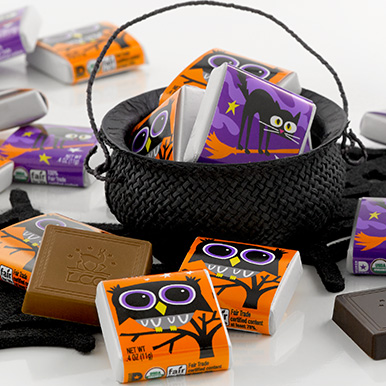Assorted Halloween themed chocolate squares inside a mini cauldron