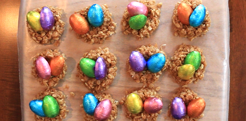 coconut Easter egg nests filled with brightly colored chocolate eggs