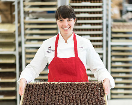 Kate Brown holding a try of chocolate covered cherries