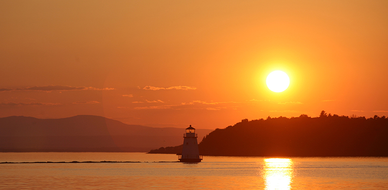 orange and yellow sunset over Lake Champlain
