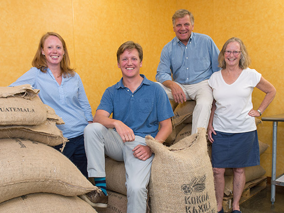The Lampman family with sacks of cacao pods