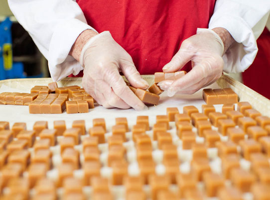 separating caramels by hand