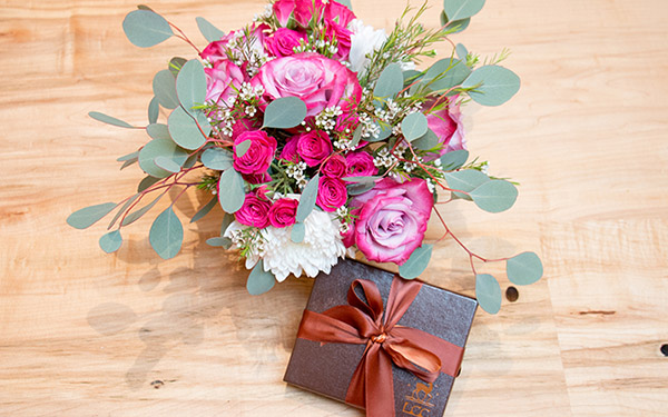 pink flowers and a box of chocolates